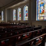 South church sanctuary wall with stained glass